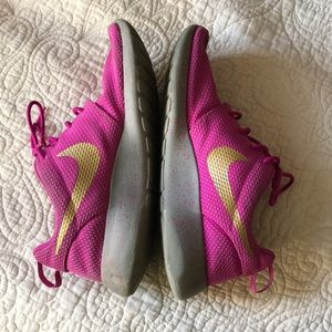 Bright Pink and Gold Nike Roshes
